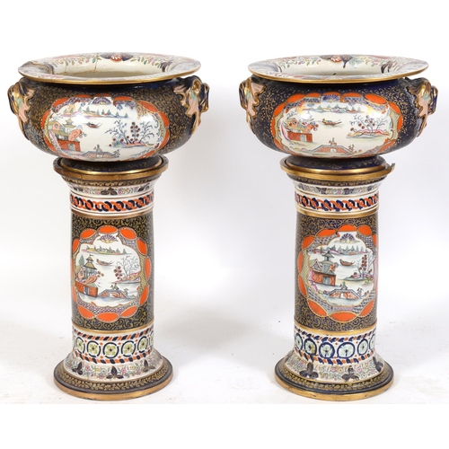 720 - A large pair of Mason's Ironstone jardinieres on stands, decorated Eastern scenes, damages, 55 cm di...
