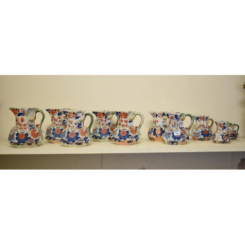 740 - A graduated set of ten Mason's Ironstone Hydra jugs, decorated flowers with serpent handles, the lar...