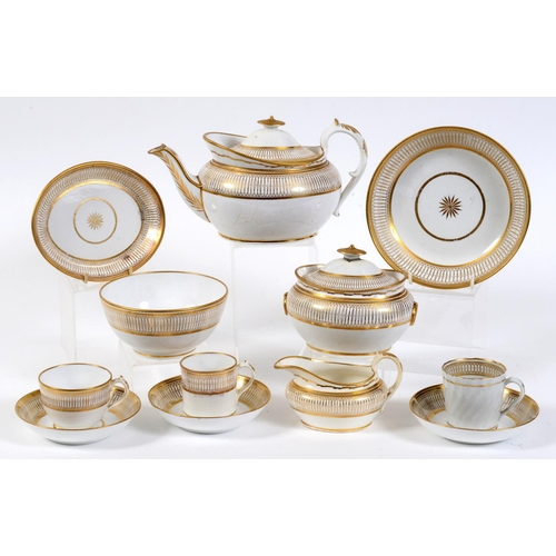 744 - An early 19th century porcelain part tea set, probably Miles Mason, with gilt decoration, the teapot...