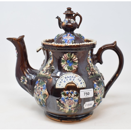 750 - A Bargeware teapot and cover, 'GOD BLESS OUR HOME', slight restoration, 28 cm high...