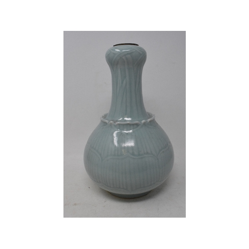 748 - A Chinese Celadon ground vase of baluster form, moulded lotus leaves, six character mark in undergla...