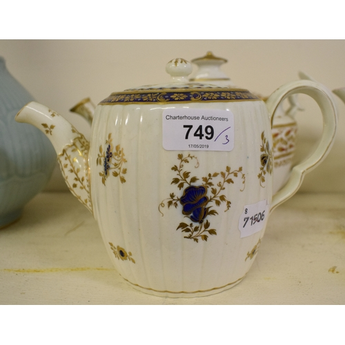749 - A Caughley porcelain teapot, with blue and gilt decoration, an early 19th century Coalport porcelain...