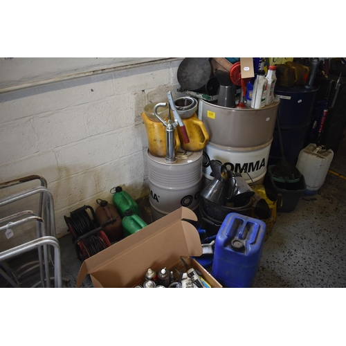 36 - Assorted oils, oil cans, and workshop equipment (qty)...