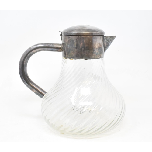 1 - A glass and silver plated lemonade jug, with a removable glass tube for ice, 24 cm high...
