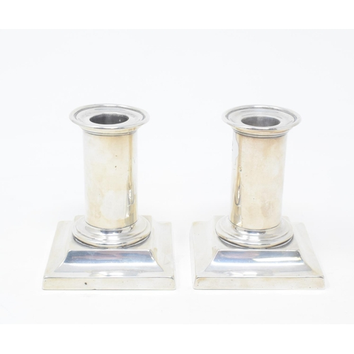 100 - A pair of Victorian silver dwarf candlesticks, London 1873, 9.5 cm high (2)...