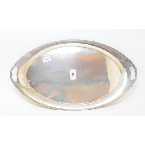 12 - A silver two handled tray, of navette form, with a reeded border, Sheffield 1966, approx. 27.7 ozt, ...