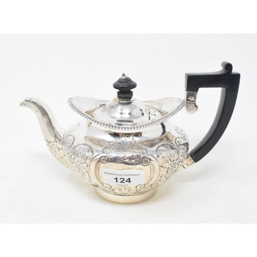 124 - A silver teapot, with later embossed decoration, London 1810, approx. 13.3 ozt (all in)...