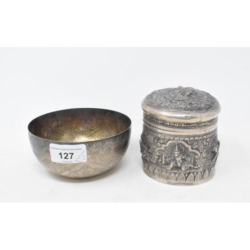 127 - An Indian silver coloured metal box and cover, embossed flowers and foliage, 9.5 cm high, and a silv...