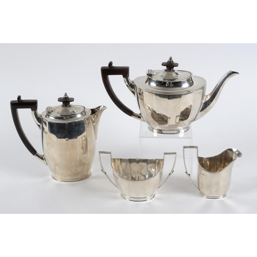 129 - A silver four piece tea and coffee service, Sheffield 1928/29, approx. 38.8 ozt, and a pair of Conti...