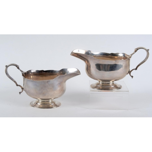 132 - A pair of 18th century style silver sauce boats, on pedestal bases, London 1936, approx. 23.4 ozt (2...