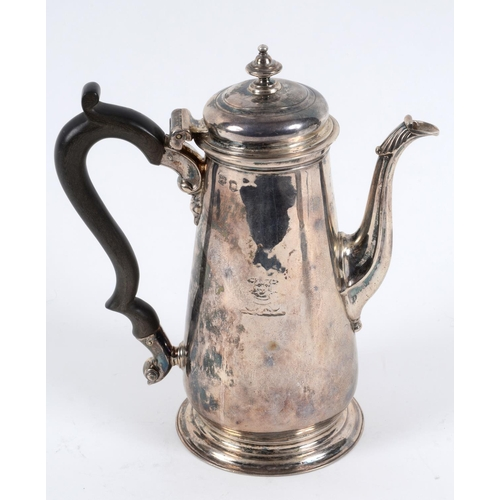 135 - An 18th century silver coffee pot, crested, of baluster form, marks indistinct, approx. 18.6 ozt (al...