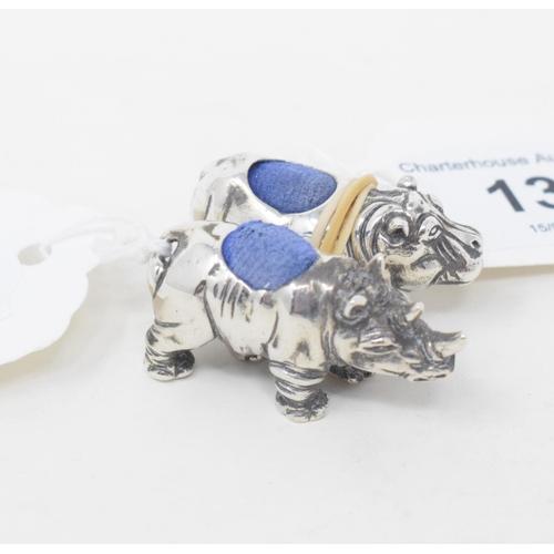 137 - A silver hippo pincushion and a silver rhino pincushion (2)...