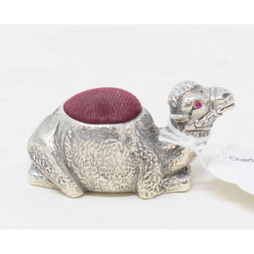141 - A silver plated camel pincushion...
