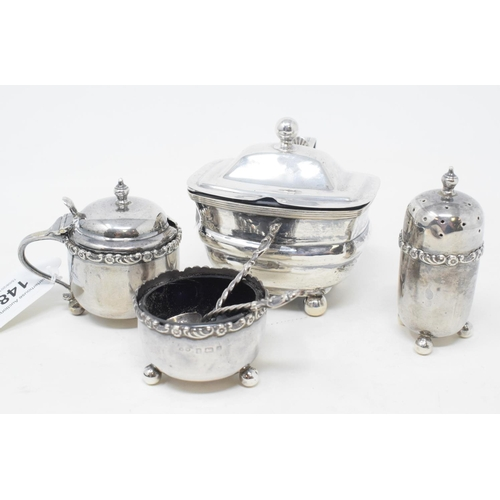 148 - A silver mustard pot, Birmingham 1917, other silver condiments and two silver condiment spoons (6)...