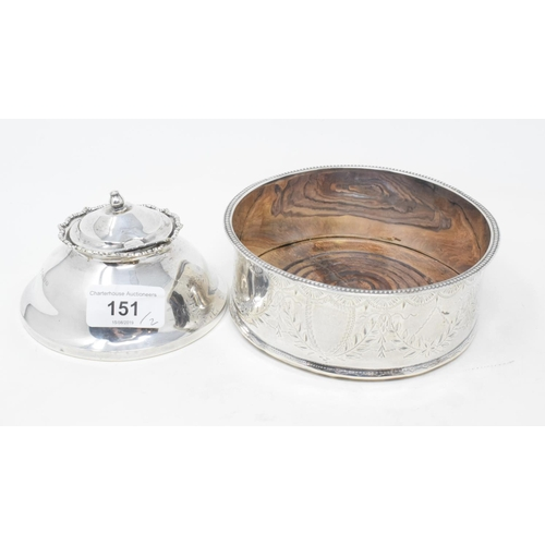151 - A silver wine coaster, with engraved foliate decoration, marks rubbed and a silver inkwell (2)...