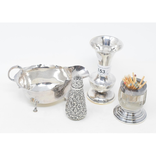 153 - An American sterling silver pepperette, Black, Starr & Frost, New York, a silver sauce boat, a silve...