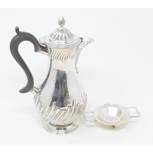 156 - A Victorian silver hot water jug, with presentation inscription, London 1889, marks rubbed, and a si...