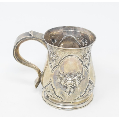 157 - A George II silver christening mug, later embossed flowers and foliage, Richard Bayley, London 1740,...