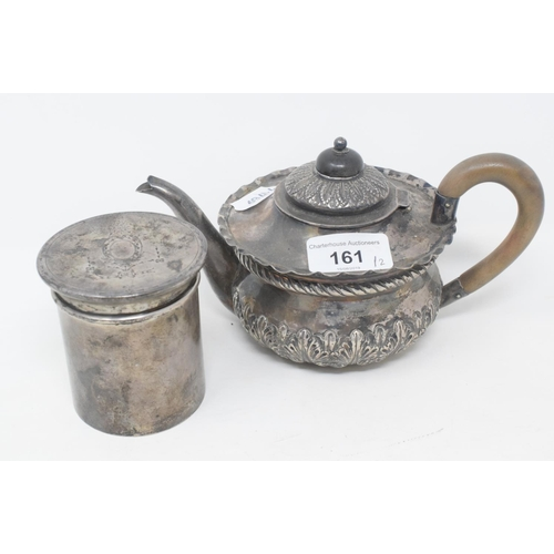 161 - A silver teapot, with embossed decoration, London 1898, and a silver cylindrical box and cover, with...