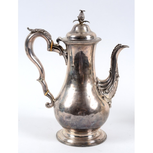 177 - A late 18th century silver coffee pot, of baluster form, with a pineapple finial, and acanthus leaf ...