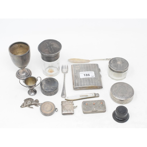 186 - A silver vesta, initialled, Chester 1904, a silver cigarette case, a silver egg cup, approx. 5.5 ozt...