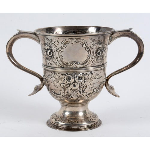 188 - A mid-18th century silver two handled trophy cup, with later embossed decoration, Thomas Wynne (of B...