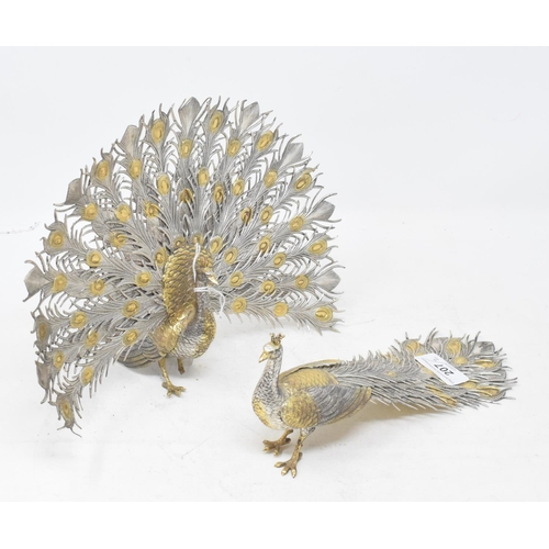 207 - A pair of table ornaments, in the form of a peacock and a peahen (2)...