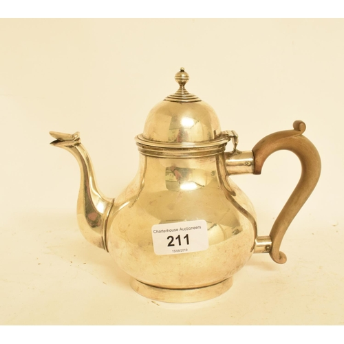 211 - An 18th century style silver teapot, of baluster form, with a boxwood handle, London 1915, approx. 1...
