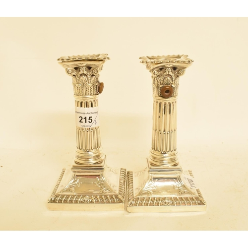 215 - A pair of late Victorian silver Corinthian column candlesticks, drilled for electricity, Sheffield 1...