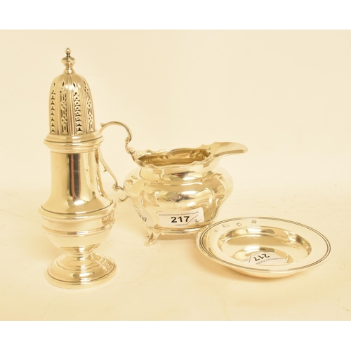217 - A silver sugar caster, marks rubbed, Birmingham 1965, a silver dish, and a silver milk jug, appox. 1...