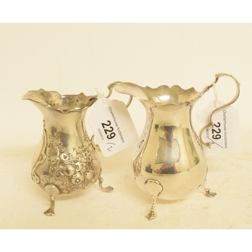 229 - A George III style silver cream jug, London 1874, and another similar, approx. 5.9 ozt (2)...