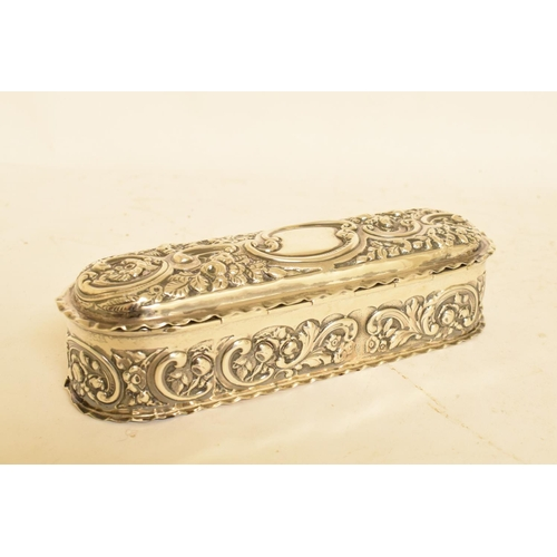 232 - A late Victorian silver box, of rounded rectangular form, with embossed decoration, London 1897, app...