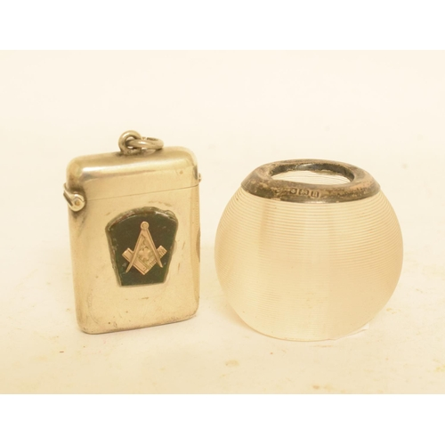 246 - A silver mounted glass matchstrike, Birmingham 1912, and a silver vesta case (2)...