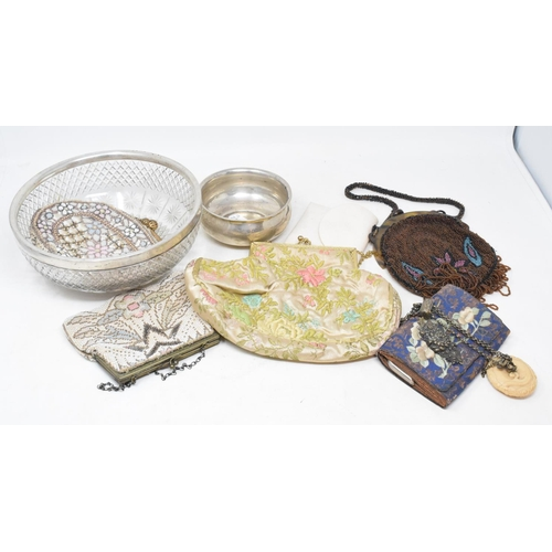 257 - A silver coloured metal part dressing table set, a silver bowl, a group of evening bags, and other i...