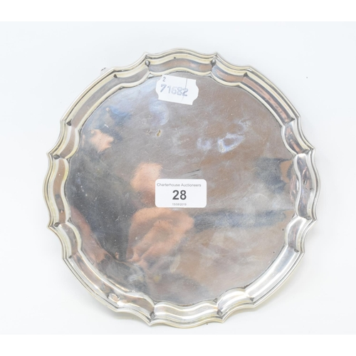 28 - An 18th century style silver salver, on three scroll feet, Sheffield 1932, approx. 9.6 ozt, 20.5 cm ...