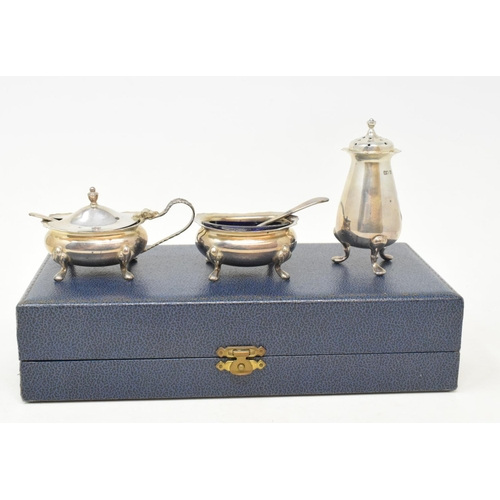 30 - A silver three piece condiment set, Birmingham 1992, cased, and assorted silver plated items...