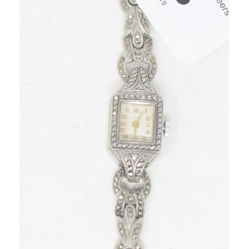 303 - A lady's Art Deco style silver coloured metal and marcasite cocktail watch...