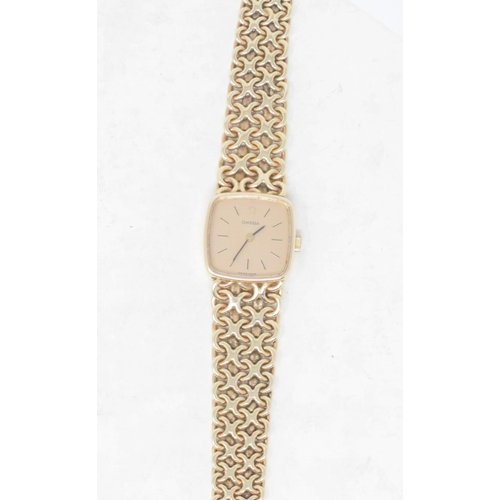 312 - A lady's 9ct gold Omega wristwatch, with baton indices and integral bracelet, boxed...