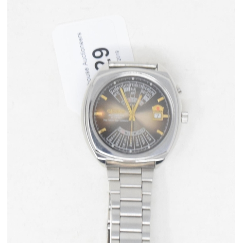 329 - A gentleman's stainless steel Orient automatic wristwatch, the smokey dial with a calendar and baton...