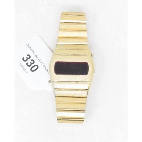 330 - A gentleman's gilt metal Carronade quartz digital wristwatch, boxed with papers...