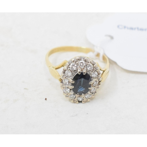 334 - **Revised estimate** A 9ct gold, sapphire and diamond cluster ring, approx. ring size M...