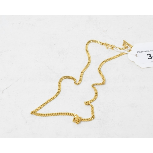 341 - A yellow coloured metal flat link chain...
