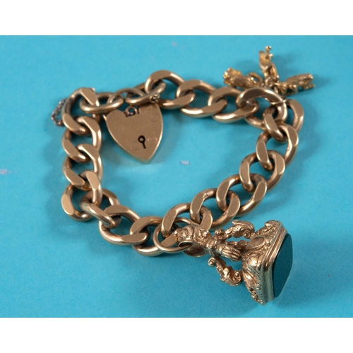 344 - A 9ct gold bracelet, with three charms, approx. 52.1 g, and a seal See illustration...