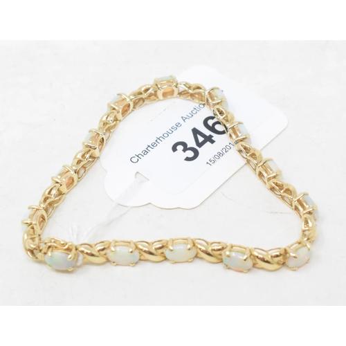 346 - A 9ct gold bracelet, set fourteen opals...