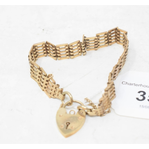 352 - A 9ct gold gate link bracelet, with padlock clasp, approx. 14.9 g...