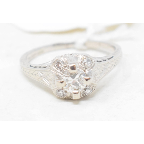 360 - An Art Deco 18ct white gold, platinum and diamond ring, with a cluster of five brilliant cut stones,...