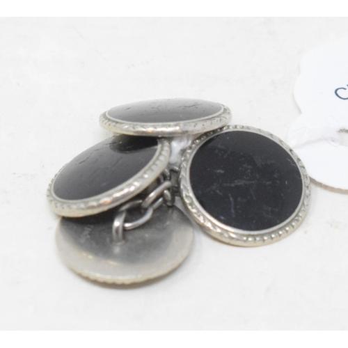 363 - A pair of platinum and onyx cufflinks...