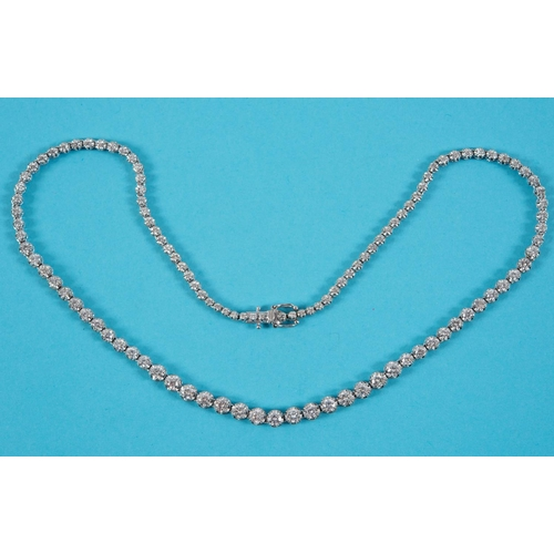 366 - An 18ct white gold necklace, set graduated diamonds, with an approx. weight of 7.5ct See  back cover...