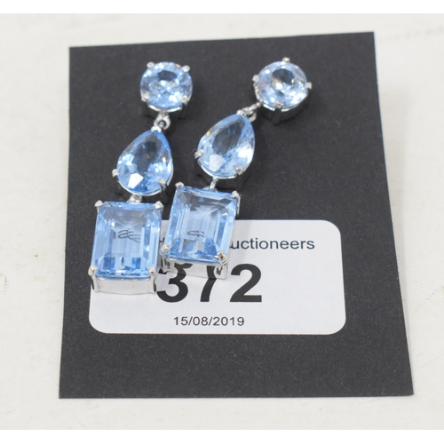 372 - A pair of silver, blue topaz and aquamarine drop earrings...