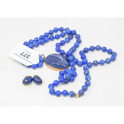 377 - A lapis lazuli bead necklace, a matching pendant and a pair of earrings...